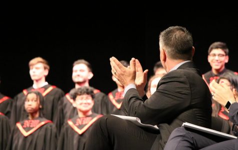 Principal Dr. Ness applauding after choir's beautiful finish for accolades night.