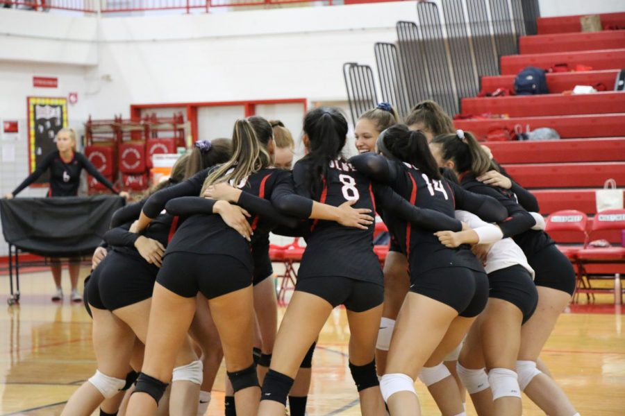 Niles+West+girls+varsity+volleyball+doing+their+pregame+ritual.