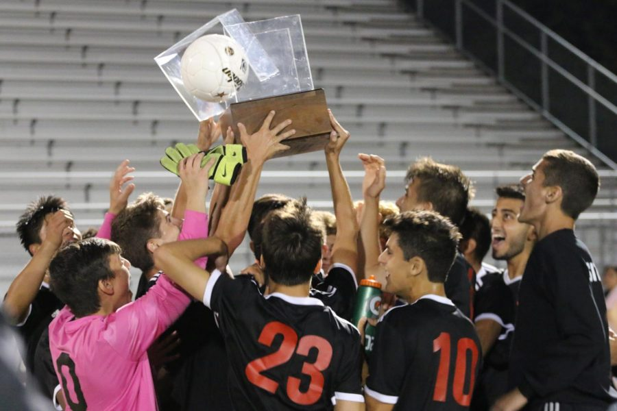 West celebrating after keeping the trophy yet again.
