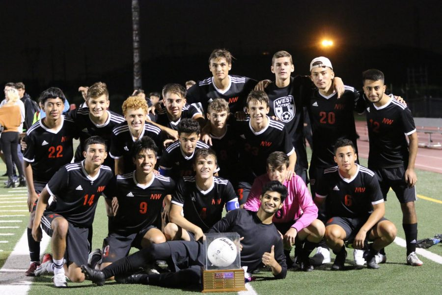 Niles West boys varsity soccer team with the Crosstown traveling trophy.