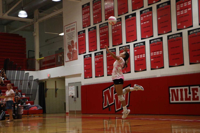 Sophomore+Kirsten+Nicolas+jump+serving.