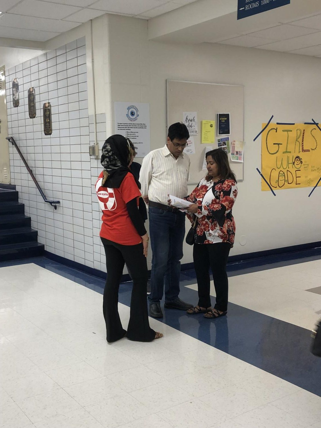 An Open House volunteer guides parents to their next class.