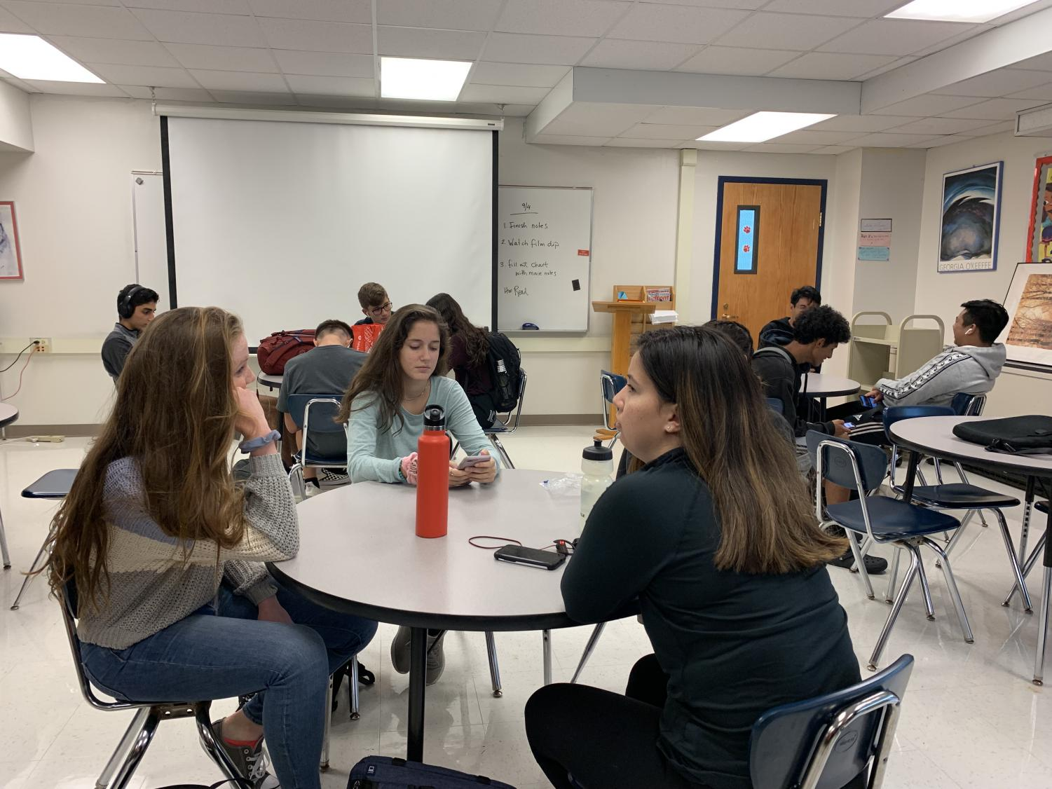 Juniors conversing during homeroom.