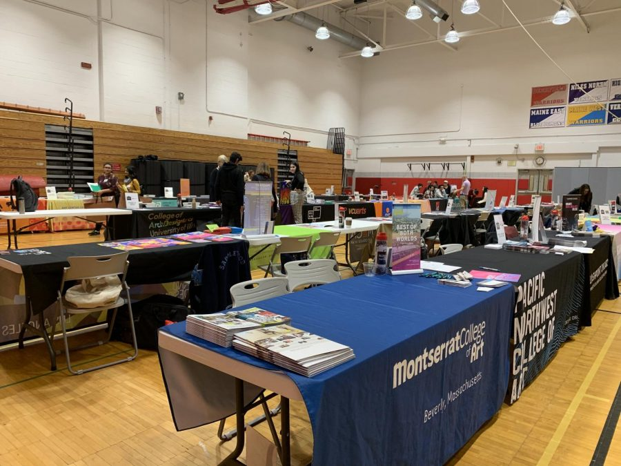 The+college+tables+are+set+up+for+the+rush+of+art+students+to+come+in+and+talk+to+college+scouts+and+representatives.