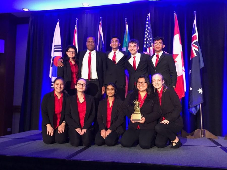 The+Mock+Trial+team+poses+after+winning+8th+place+at+the+Empire+World+Championships+in+New+York.