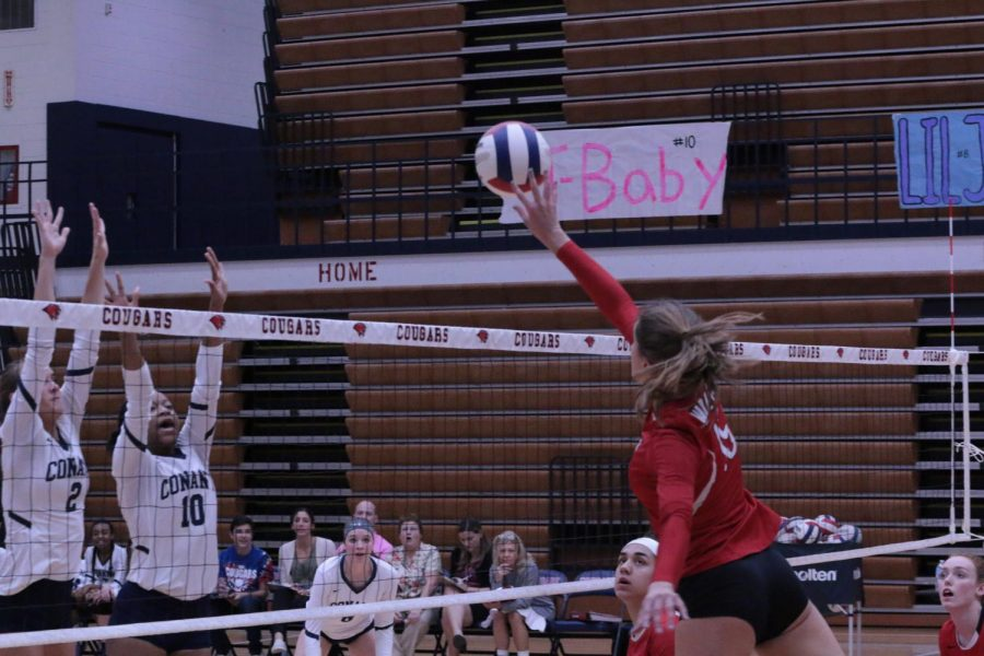 Junior Magdalena Soldo tipping the ball over the net.