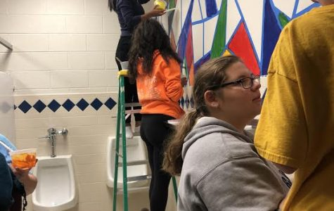 Members of National Honor Society paint bathrooms at Lincoln Junior High School.