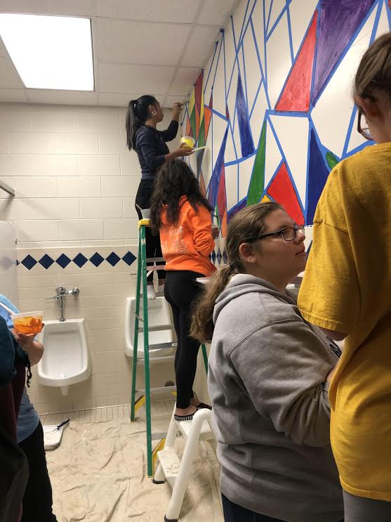 Members+of+National+Honor+Society+paint+bathrooms+at+Lincoln+Junior+High+School.
