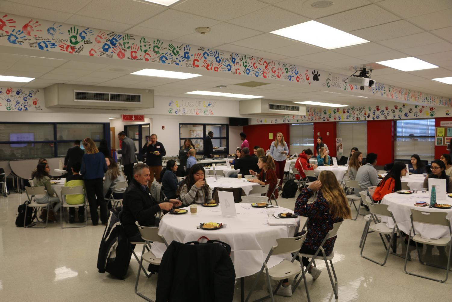 Students, Board Members, and Administrators convene over breakfast to discuss issues at Niles West.