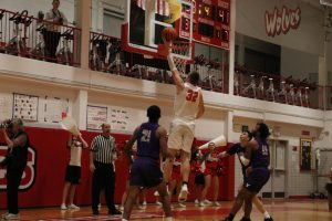 Senior Adnan Seferovic going up for a layup and scoring two points for the wolves.