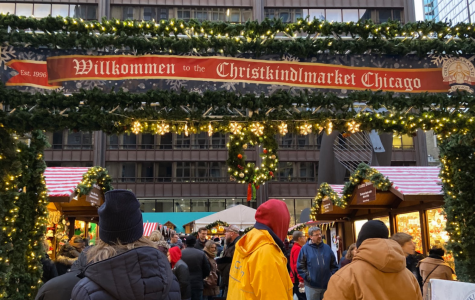 People entering the Christkindlmarket through the festive main entrance.