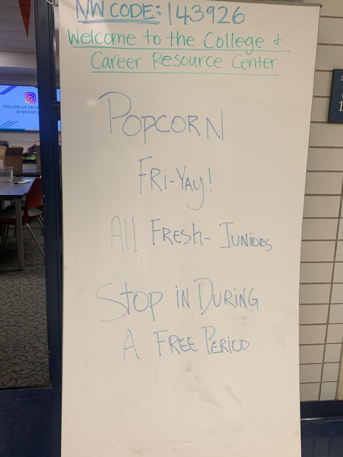 College Resource Drop in Day is advertised with a whiteboard outside of the center