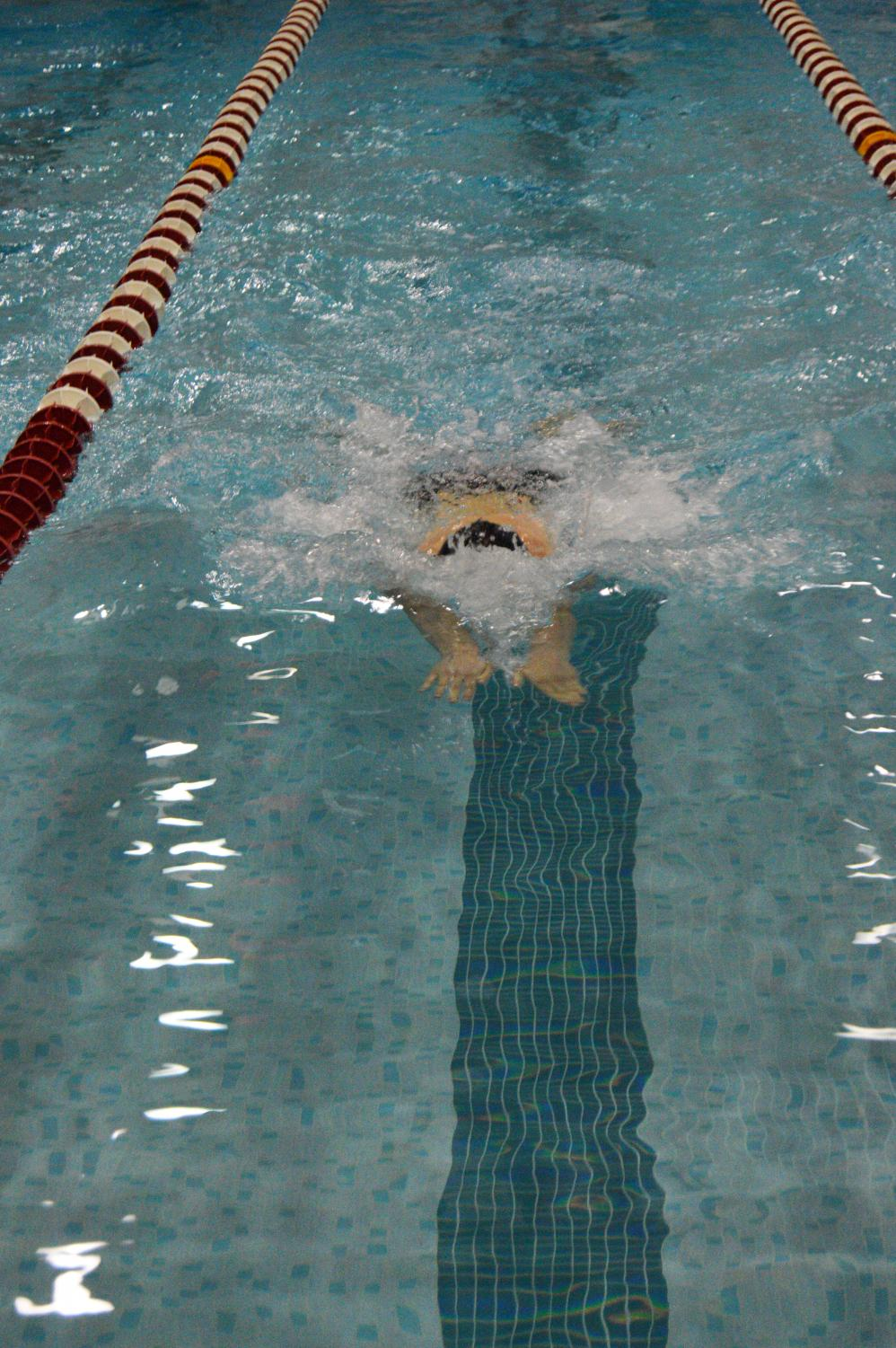 Niles+West+varsity+swimmer+in+the+middle+of+his+breaststroke.+