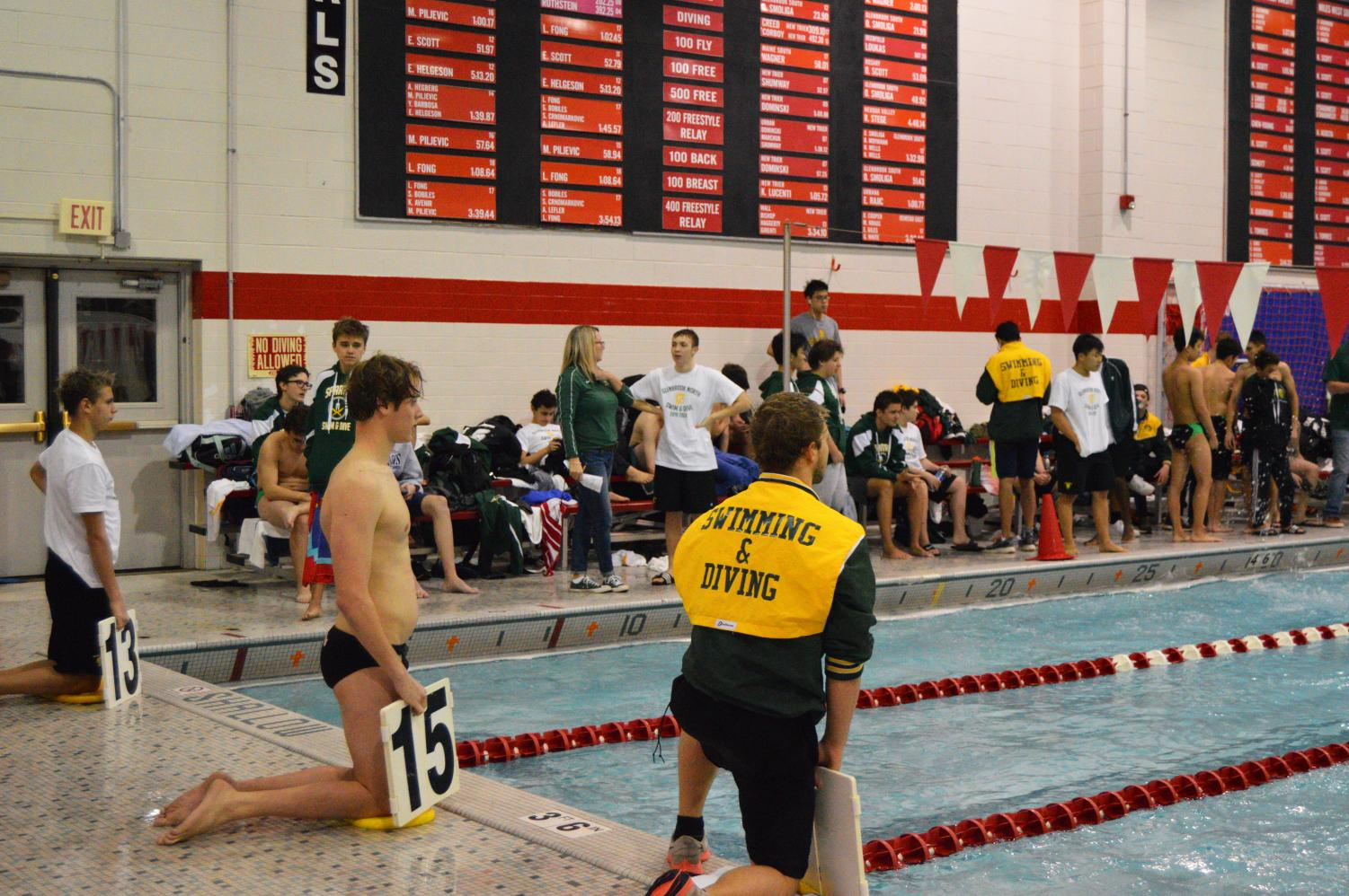 Varsity+swimmers+helping+their+teammates+keep+count+of+their+laps+during+the+grueling+500+yard+freestyle+event.+