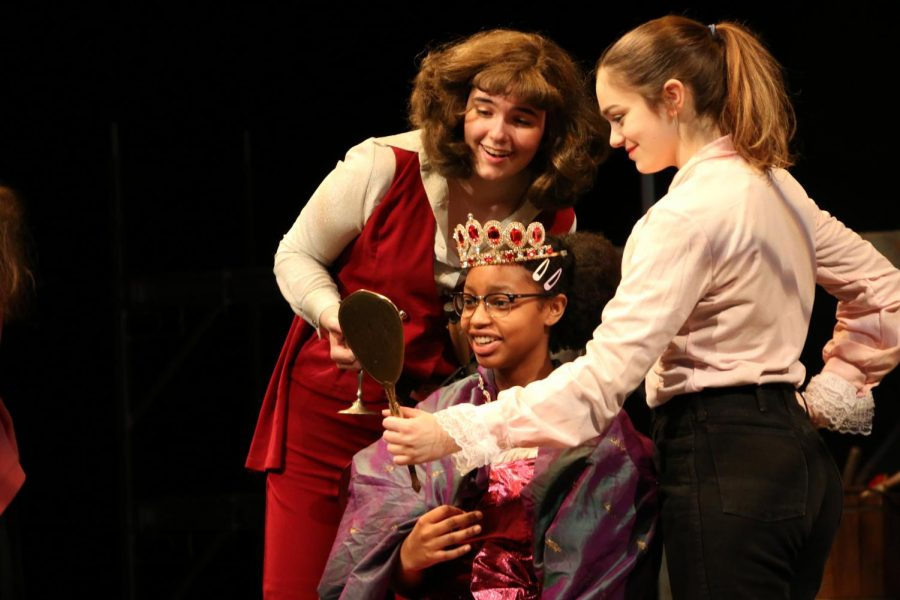 Captain Hook played by Ella Rousseau and pirate Skylights played by Mia Finnigan give Wendy Darling a makeover.