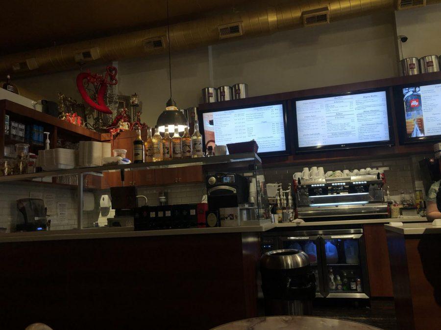 The register and menus  as you walk into Leonidas.