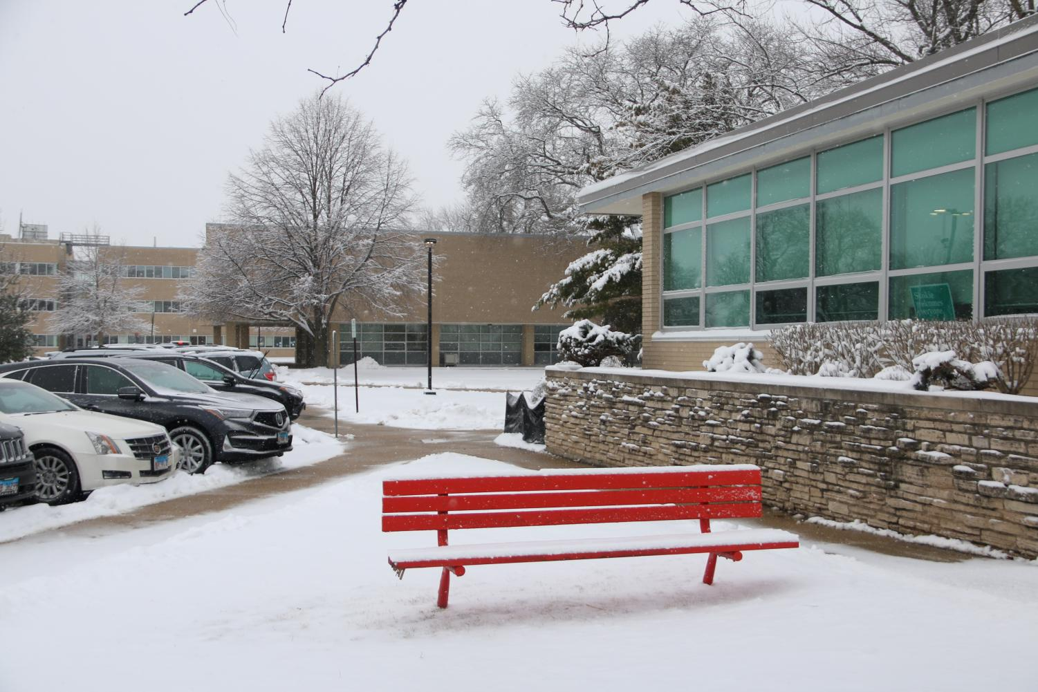 Beaming+red+bench+covered+in+snow+along+the+main+office.+