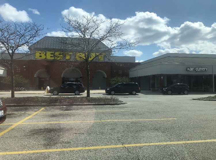 Customers at Best Buy wait outside in their cars for online pick up.
