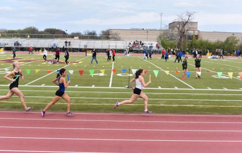 Senior Jamie Lawrence participating in a track and field meet.