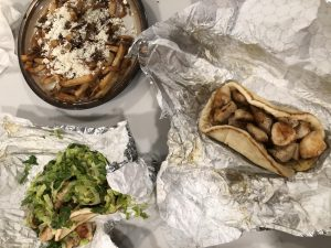 The chicken pita, pita with toppings and greek fries.