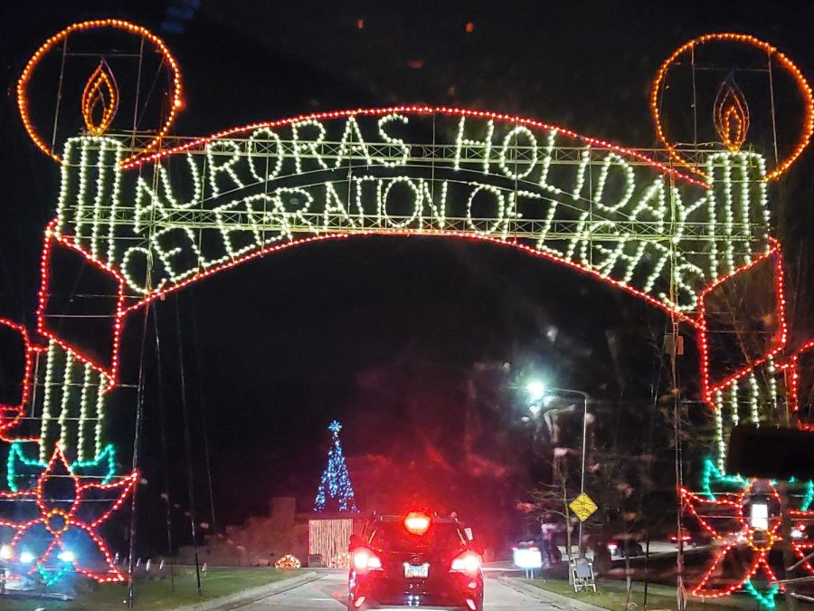 The festive entrance gate shows the name of the event; 'Auroras Holiday Celebration of Lights'.