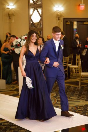 Hanna and her brother Emil pictured walking out together at their uncle's wedding.