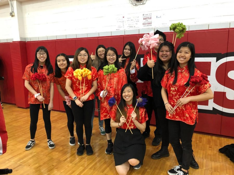 Chinese club members in traditional Chinese clothing.