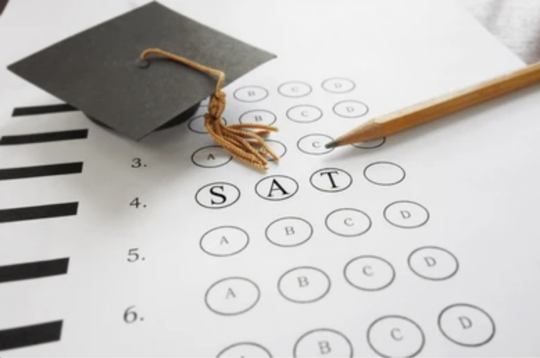 An exam answer sheet with the word SAT bubbled in alongside a pencil and graduation cap.