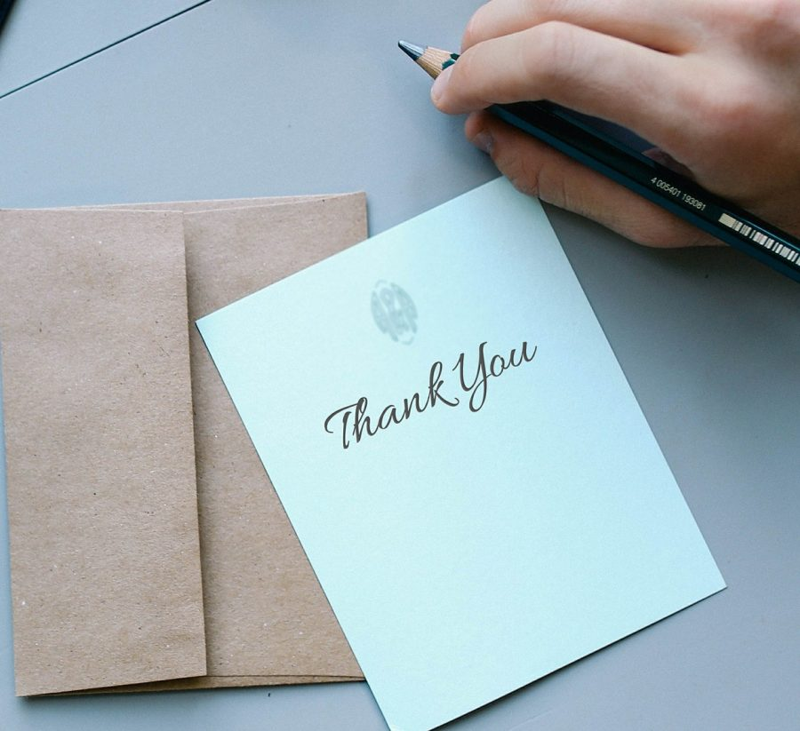 A handwritten thank you card.