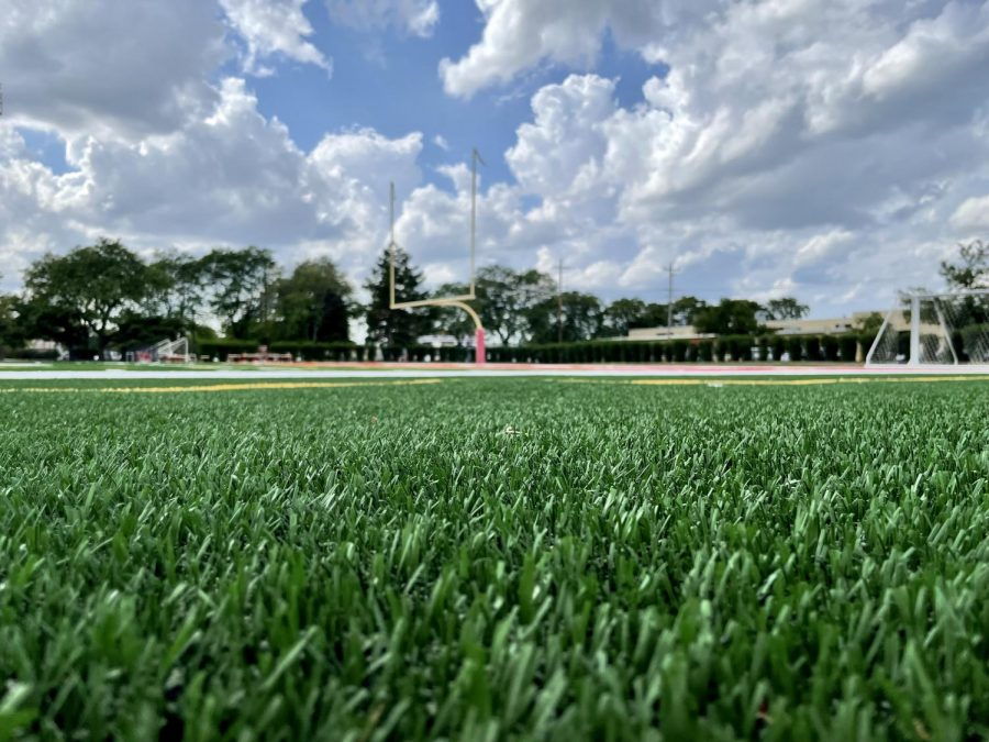The new turf on the football field is still bright and green, hardly trampled by the many practices this year.