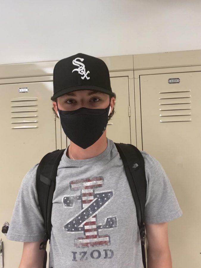 Senior+Sean+Carey+wearing+a+baseball+cap+in+the+Niles+West+halls.+