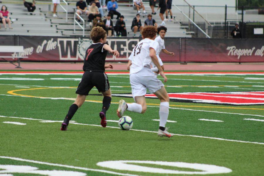 Junior Ben Divovich takes space into the midfield.