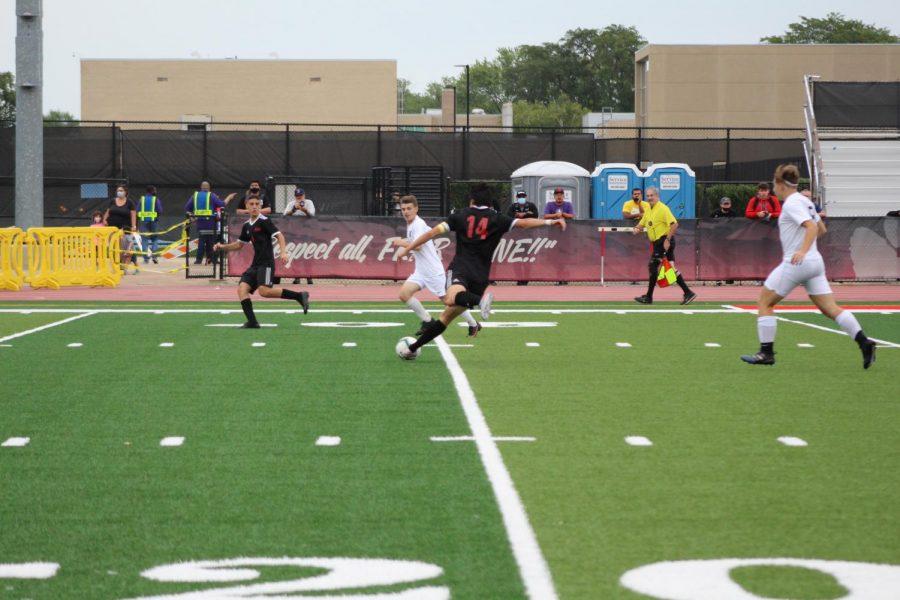 Senior Daniel Navarro clears the ball.