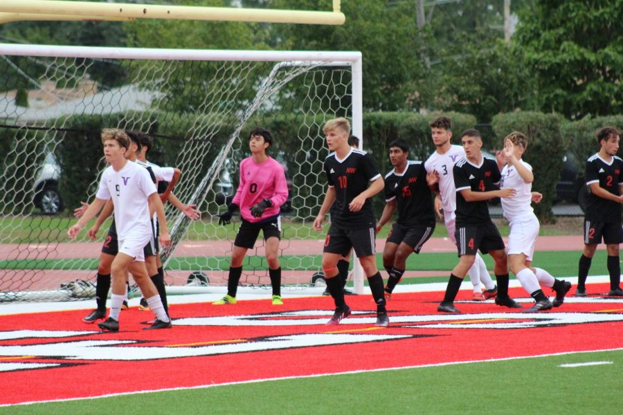 Players waiting to defend a corner kick.