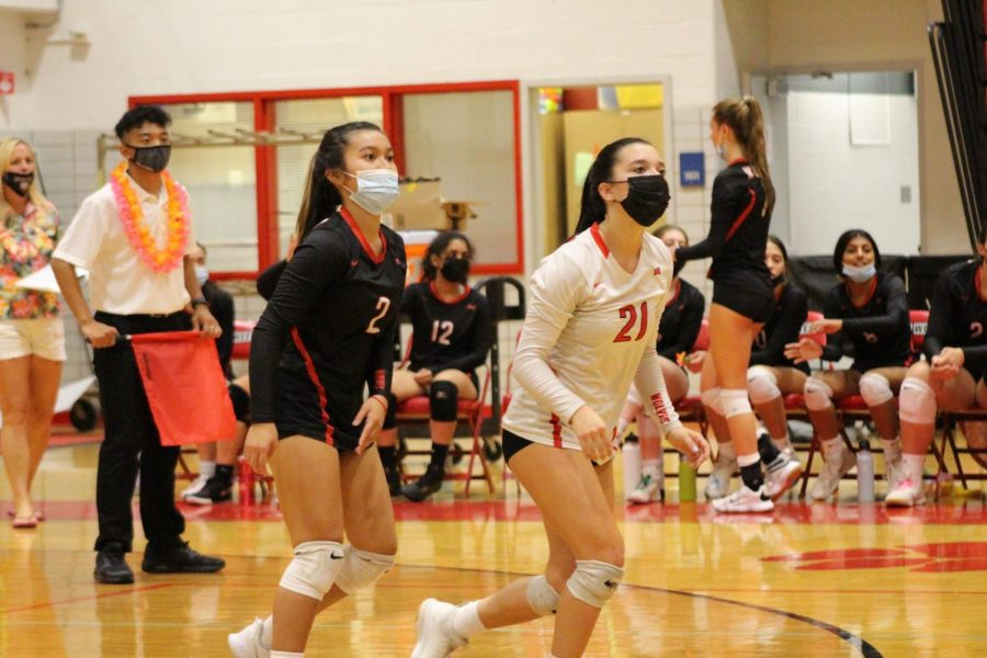 Seniors Elysa Stavropoulos and Kirsten Nicolas waiting for the ball.
