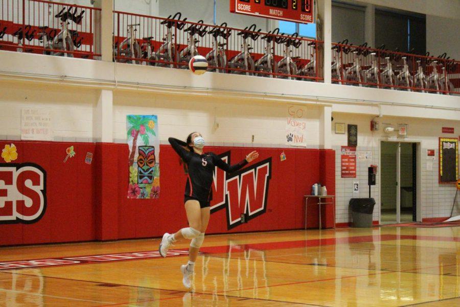 Senior Jessica Palmer serving.