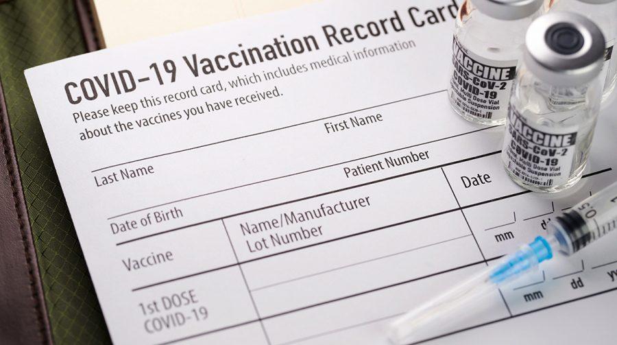 A+COVID-19+vaccination+record+card.+