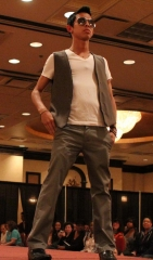 Senior Bryan Taico struts down the catwalk in last Spring's Fashion Show Photo by Amy Chow